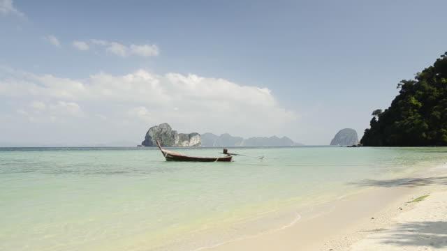 WS View of Long tail boat and Limestone rock in Sea, Marine National Park / Ko Hai, Krabi, Thailand