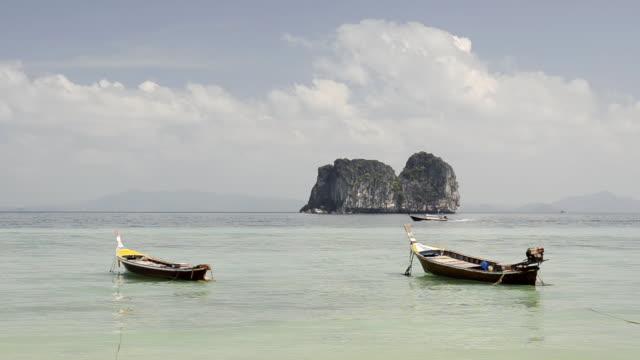 WS View of Long tail boats and Limestone rock in Sea, Marine National Park / Ko Hai, Krabi, Thailand