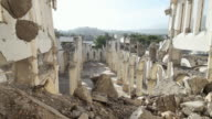 WS View of Looking down on ruins of cathedral of our lady of assumption with rubble and mountains / Port-au-Prince, Haiti