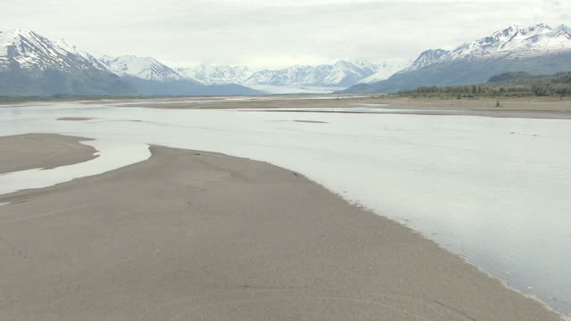 MS AERIAL TU View of low over sandbar of Knik river to mountains / Alaska, United States