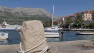 View of Luka Korculanska Bay and boats at Korcula Old Town, Korcula, Dalmatia, Croatia, Europe