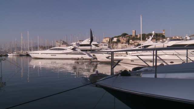 MS View of Luxury yachts  moored in old port  / CANNES, Provence-Alpes- CÌ«te d'Azur, FRANCE