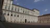 WS LA View of Main entrance to Royal Palace with italian flag / Turin, Piedmont, Italy