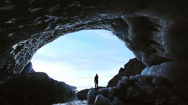 WS View of Male figure walking in glacier Ice Cave Svinaffellsjokull glacier / Iceland