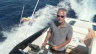 MS TS View of Man driving power speedboat in sea / Palma de Majorque, Majorque, Spain