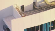 WS AERIAL View of man on top of building calling to eagle / Brisbane, Victoria, Australia