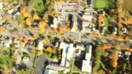 MS AERIAL View of Manchester town and autumn color trees / Vermont, United States