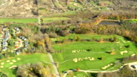 MS AERIAL PAN View of Manchester town with golf course and autumn color trees / Vermont, United States