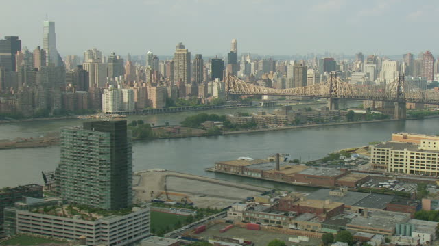 WS AERIAL View of Manhattan buildings from across river / New York, United States