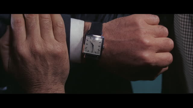 CU View of man's wristwarch'
