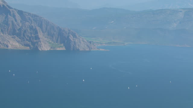 WS AERIAL View of many sailboats in open water with mountains / Ionian Islands, Greece