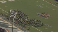 WS DS ZO AERIAL View of marching band practice in preparation for Ohio University Homecoming Parade at Paden Stadium / Athens, Ohio, United States