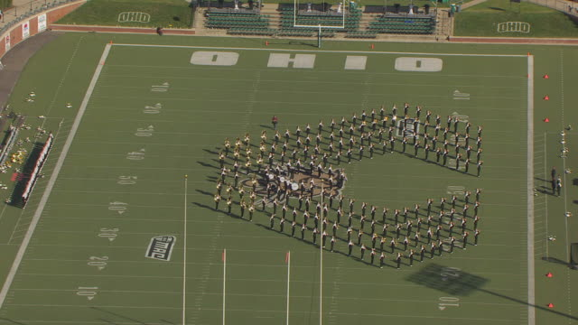 WS DS ZI AERIAL View of marching band practice in preparation for Ohio University Homecoming Parade at Paden Stadium / Athens, Ohio, United States