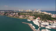 WS POV AERIAL View of marina and housing with city in background / Miami, Florida, USA