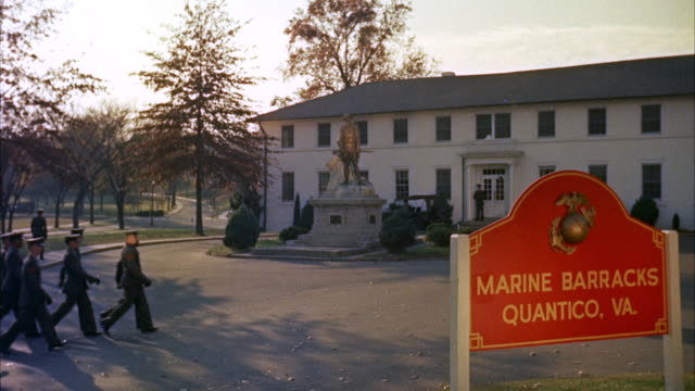 MS View of marine  barracks quantico sign and virginia - company of marines passing by road