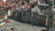MS AERIAL ZI ZO PAN View of market square with town hall / Flanders, Belgium