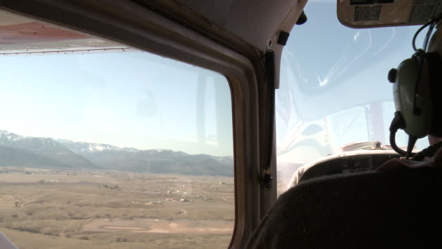 AERIAL WS View of Mature pilot flying in small aircraft / Missoula, Montana, USA