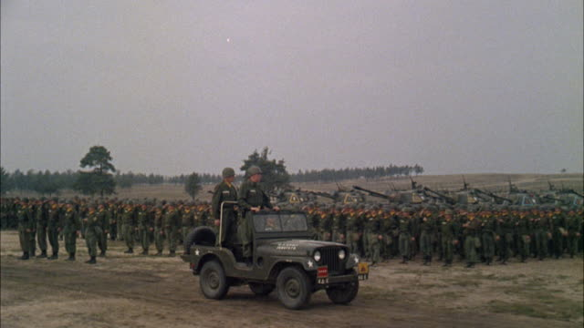 MS View of military of jeeps with soldiers