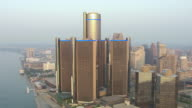 WS AERIAL POV View of modern skyscrapers in downtown at sunrise / Detroit, Michigan, United States