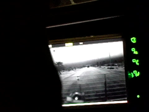 View of monitor screen inside Stryker vehicle driving down road / Baghdad Iraq / AUDIO