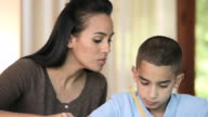 MS CU View of mother helping son for his homework / Richmond, Richmond, United States