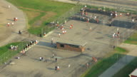WS AERIAL ZI View of  Mound Correctional Facility with inmates exercising in yard / Detroit, Michigan, United States