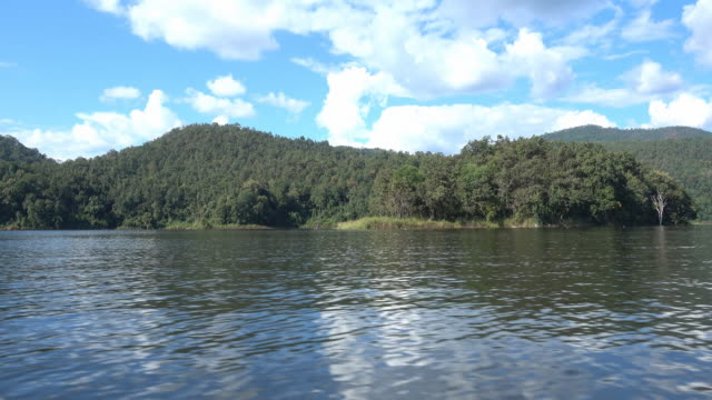 4K : View of mountain, river and blue sky on the boat along the river in Thailand