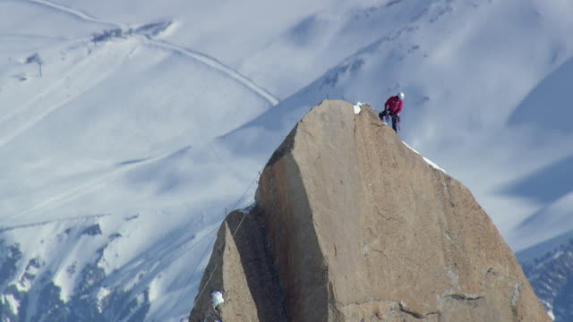 WS AERIAL View of Mountaineer person on cliff / Switzerland