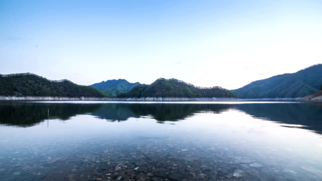 View of mountains and a reflection on flowing water surface of Soyang Lake (Famous travel destination)