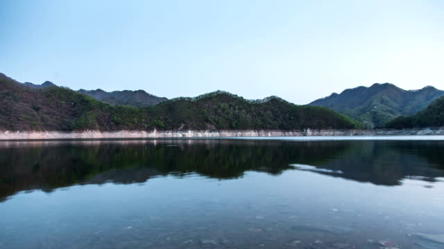 View of mountains ranges and a reflection on flowing water surface of Soyang Lake (Famous travel destination)