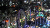 WS T/L View of musement park with cityscape in busy Bunkyo district at night / Tokyo, Japan