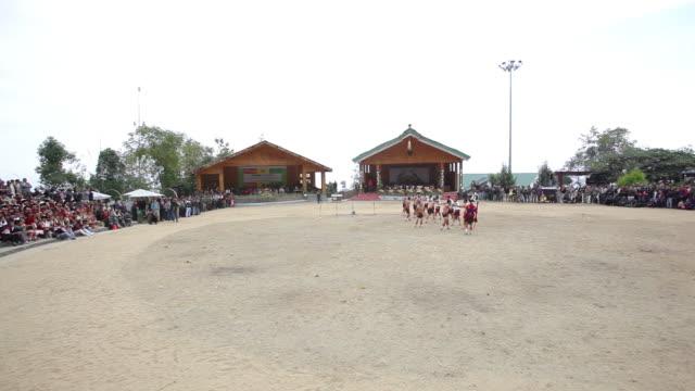 WS PAN View of Naga tribes people performing in Hornbill Festival, Kisama / Kohima, Nagaland, India
