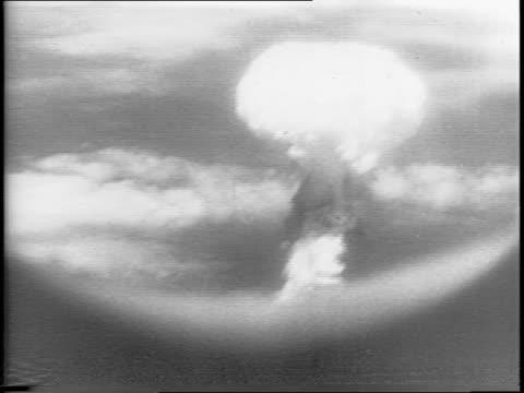 View of Nagasaki by plane / Atomic bomb blast creates a mushroom cloud below / various views of the mushroom cloud