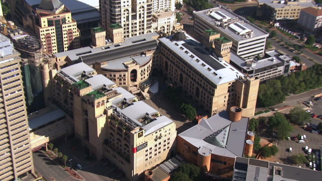 MS AERIAL ZO View of Nelson Mandela statue in Sandton square / Johannesburg, Gauteng, South Africa