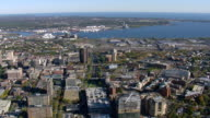 WS AERIAL ZO PAN ZI DS View of New Haven city with Harbor and cargo ship moving towards city / Connecticut, United States