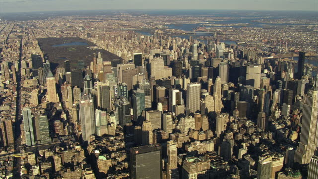 WS POV AERIAL View of New York City With skyscrapers and Central Park / New York City, New York, USA
