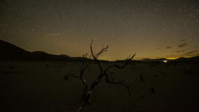 WS TU T/L View of night time astro in desert around mono lake, with moon strike / Mono Lake, California, United States