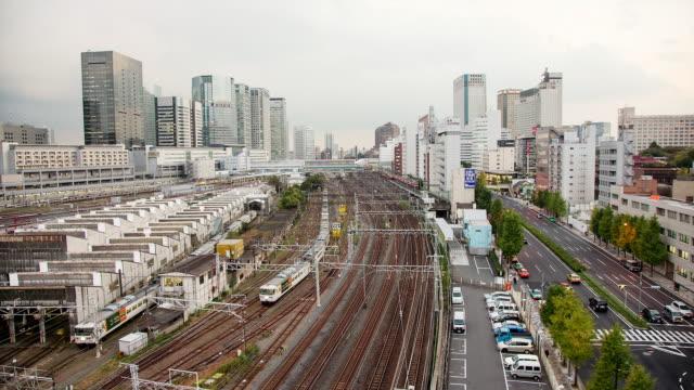 WS T/L View of night transition over shinagawa station / Tokyo, Japan