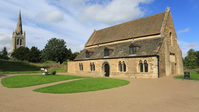 View of Oakham Castle Museum and All Saints church.