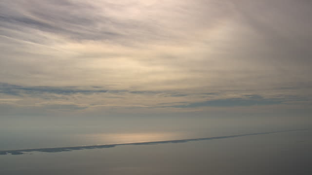 WS AERIAL View of ocean and clouds / North Carolina, United States