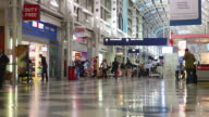 WS LA View of O'Hare International Airport interior with signs and duty free shops / Chicago, Illinois, United States