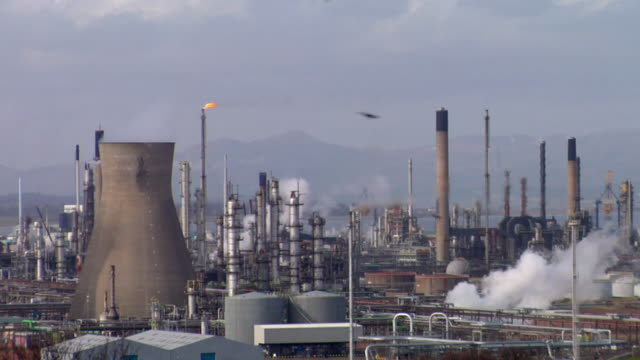 WS View of oil refinery, cooling towers and chimneys / Grangemouth, Scotland, UK