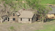MS AERIAL ZO View of Old abandoned farm house in Cimarron countyand with  farmland / Oklahoma, United States