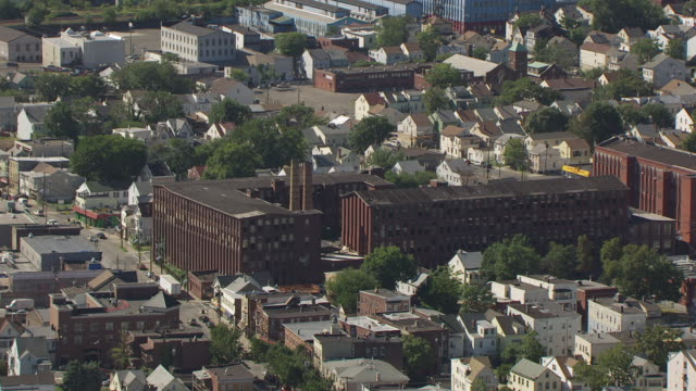 WS AERIAL View of old factory building / Paterson, New Jersey, United States