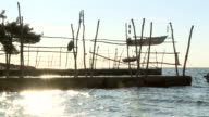 WS SLO MO View of old fishing jetty with boat suspended in air / Opatija, Primorje-Gorski Kotar, Croatia