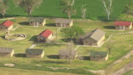 WS AERIAL ZO View of old fort buildings  with surrounding farmland in Ford County / Dodge City, Kansas, United States