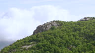 WS AERIAL POV View of Old Rag Mountain and Blue Ridge Mountains with cloudy sky / Shenandoah, Virginia, United States