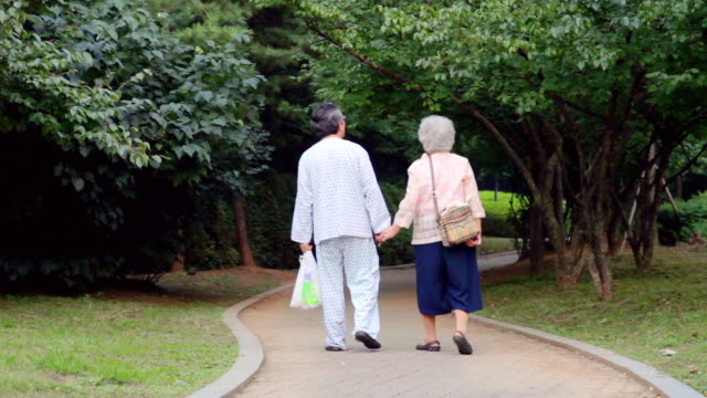 WS View of old woman and patient walking hand in hand / Seoul, South Korea