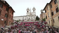 WS View of on Trinita dei Monti steps by Piazza di Spagna with full of people sitting relaxed and enjoying city / Rome, Italy