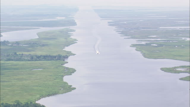 WS AERIAL View of One motor boat moving in river  / Louisiana, United States